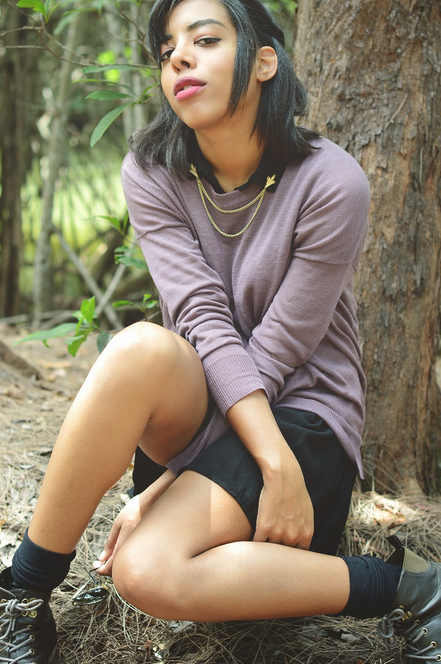 Indie fashion blogger Anais Alexandre of Down to Stars in a preppy lavender and black spring look in the forest