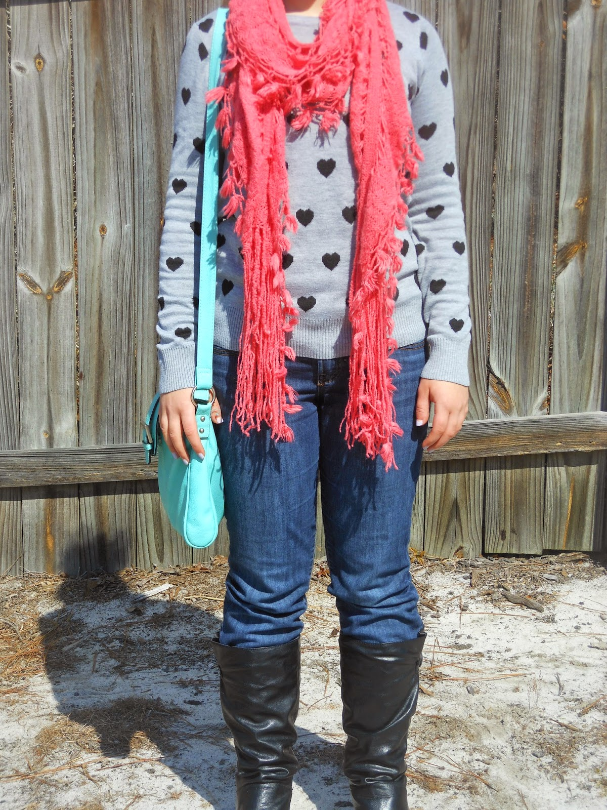 Bright Pink and Turquoise. Heart sweater, jeans, bright pink scarf, black boots, turquoise cross body purse.