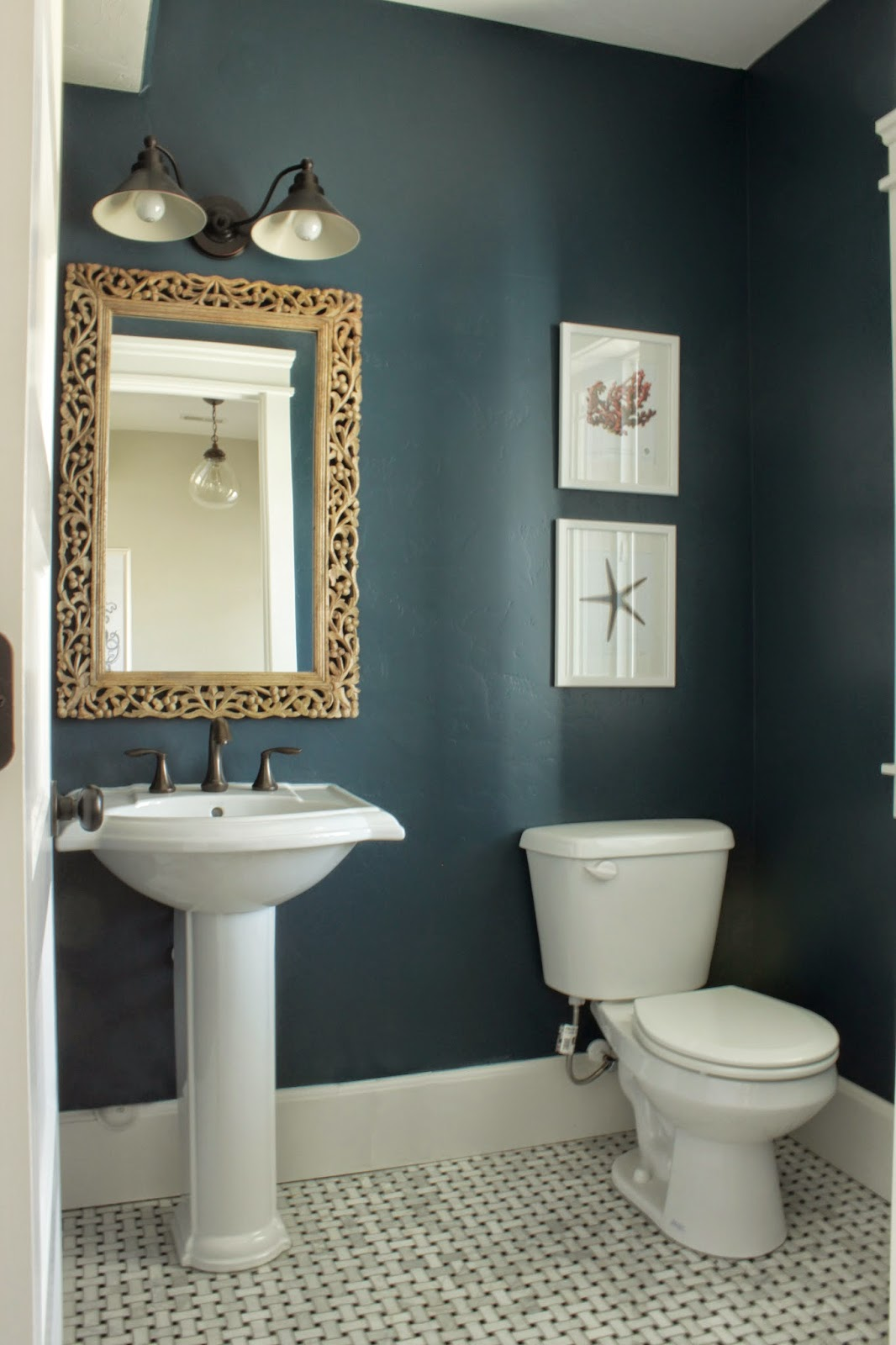 painted rainstorm by sherwin williams and the mirror is from cost plus
