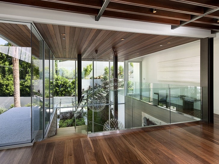 Glass stairs railing in Sunset Plaza Drive modern mansion in Los Angeles