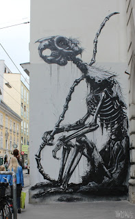 Black and white rodent mural street art