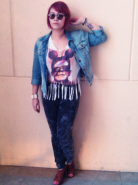 Stacy Gutierrez of The Plump Pinay is in a punk attire - shredded graphic tee,  denim  jacket, and faux arm tattoo