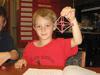 Student holding up an octahedron he made from toothpicks and clay