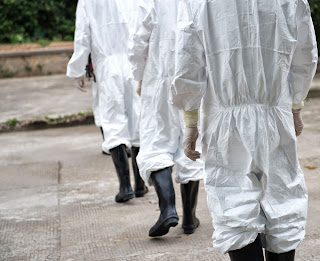 Doctors wearing protective suits.