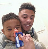 Lil Fizz and his son on Christmas