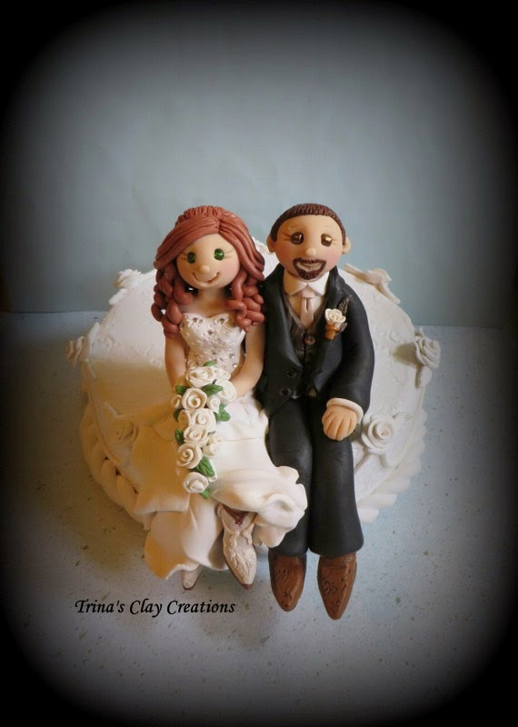 https://www.etsy.com/listing/204245624/wedding-cake-topper-custom-cake-topper?ref=shop_home_active_1&ga_search_query=bride%2Band%2Bgroom%2Bsitting%2Bon%2Bcake
