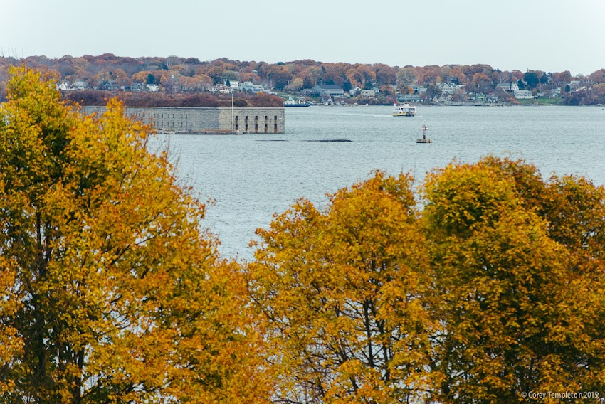 November 2015 Portland, Maine USA photo by Corey Templeton. Looking beyond the last of the fall foliage on the Eastern Promenade towards Fort Gorges and Peaks Island.