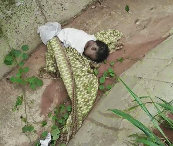 dead baby gutter benin city