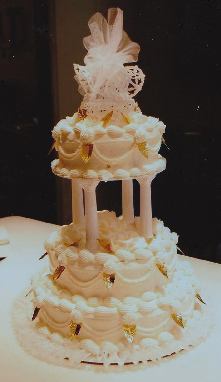 Haegeles bakery philadelphia german bakery weddings white with our soft buttercream icing the dramatic drapes and trims are trademark of the traditional style of decorating white roses on white icing mightylinksfo