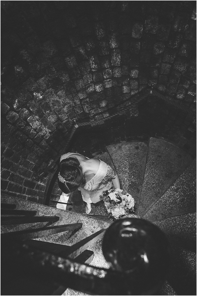 Bride on spiral staircase