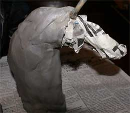 making a horse head sculpture with newspaper