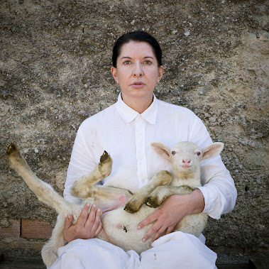 Portrait with White Lamb from the series Back to Simplicity