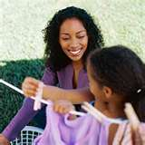 Stacy Snyder - Parent Unplugged - Time Without Fanfare - mom spending time doing laundry with child