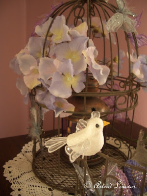 Romantic birdcage with flowers butterflies and birds