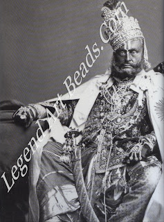 Although a leper, Raghuraj Singh, Maharaja of Rewa, was one of the few princes to make Britain's Star of India cloak and in signia look properly royal. He wore gloves and orange face paint to disguise t he worst of the disease.