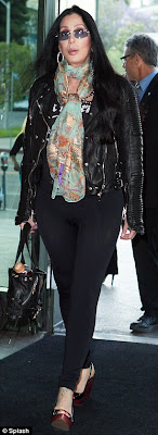 Cher struts past photographers
