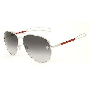 Made from shiny palladium finish steel with temples covered in red perforated kid leather
