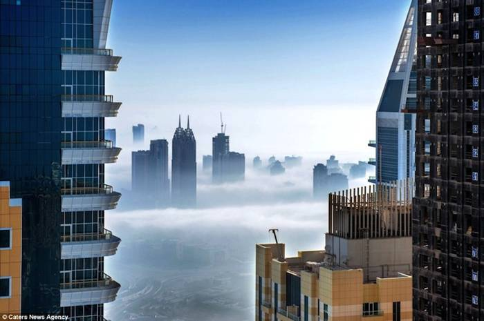Dubai-based German photographer Sebastian Opitz captures the surreal and mystical look of his adopted city as fog rolls in and out at sunrise. The photographer renames the cityscape as Cloud City for the brief moments when the mist takes over and fills the empty space between the towering buildings. Optiz's images offer a serene and dreamy view of a bustling city, re-imagining it as a heavenly metropolis in the sky.