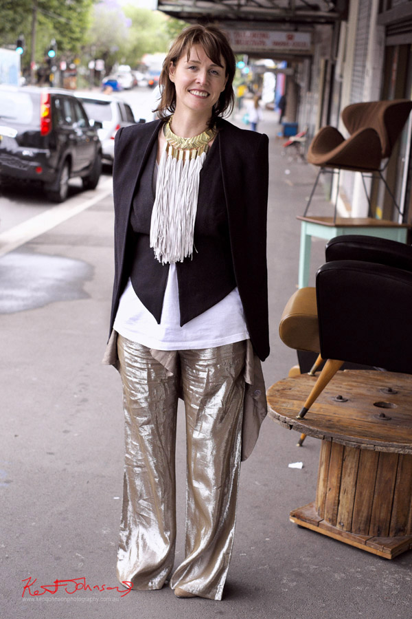 Black and White and Gold outfit, White Tee under black vest and jacket with Sass & Bide 'tribal' necklace; full leg pant in metallic gold fabric.