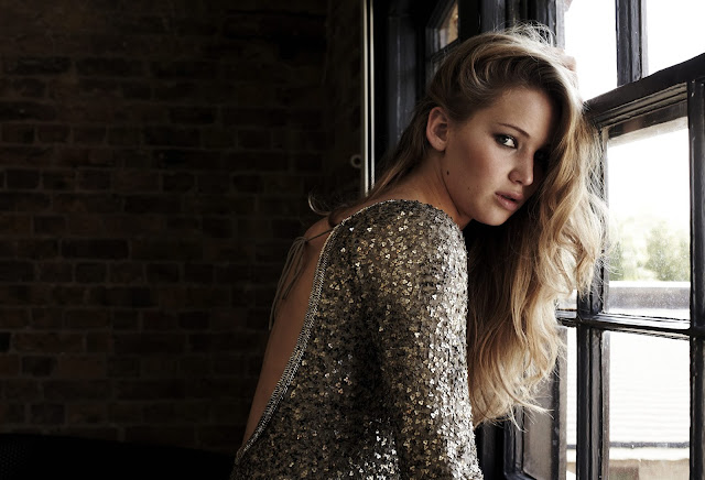 Jennifer Lawrence backless sequin gown blond hair photoshoot