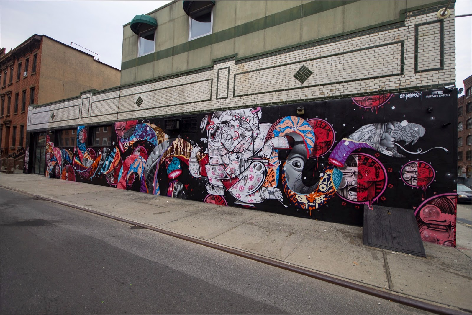 After working on a solo piece in Soho, New York, Tristan Eaton joined forces with German duo How Nosm on a new collaboration.