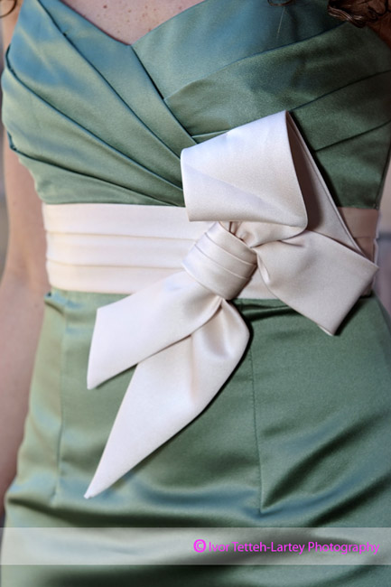 Detail image of a bow detail on bridesmaid's dress.