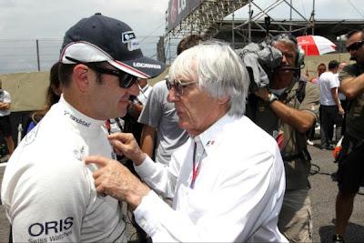 Charge de Formula 1: Barrichello e Ecclestone conversando sobre Formula 1