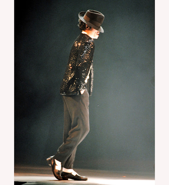 "in 1982, Jackson released his wildly successful solo album, Thriller, which won a record-breaking nine Grammys. During this time Jackson patented his ""Moonwalk"" dance and began wearing his signature rhinestone glove."