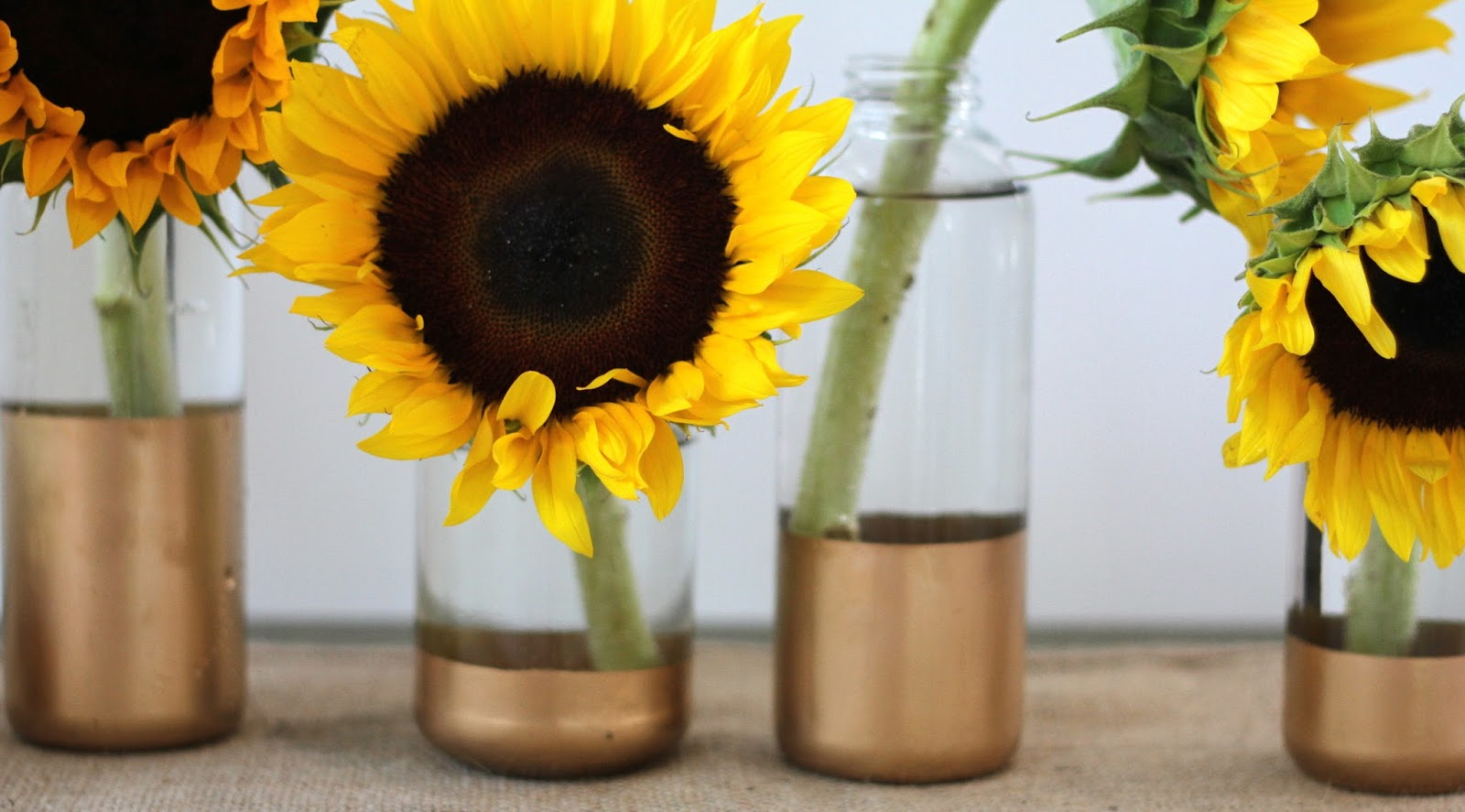Open door diy gold dipped vases and bottles for several months one sunday afternoon we lined everything up and cranked out about 30 glasses this project has limitless possibilities reviewsmspy