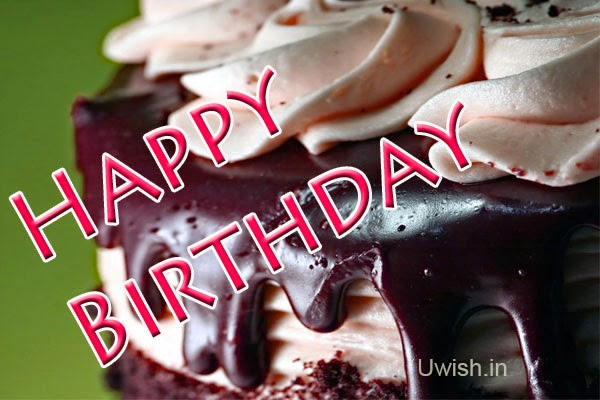 Happy birthday  e greetings and wishes, with delicious chocolate cream cake.