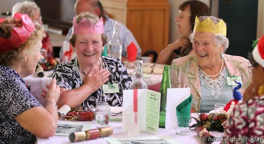 L-R: Valda Hampton, Taradale, Judy Peterson, Taradale, Bernice Snell, Greenmeadows, Napier, at a free community lunch on Christmas Day, at All Saints Taradale, in Taradale, Napier. photograph