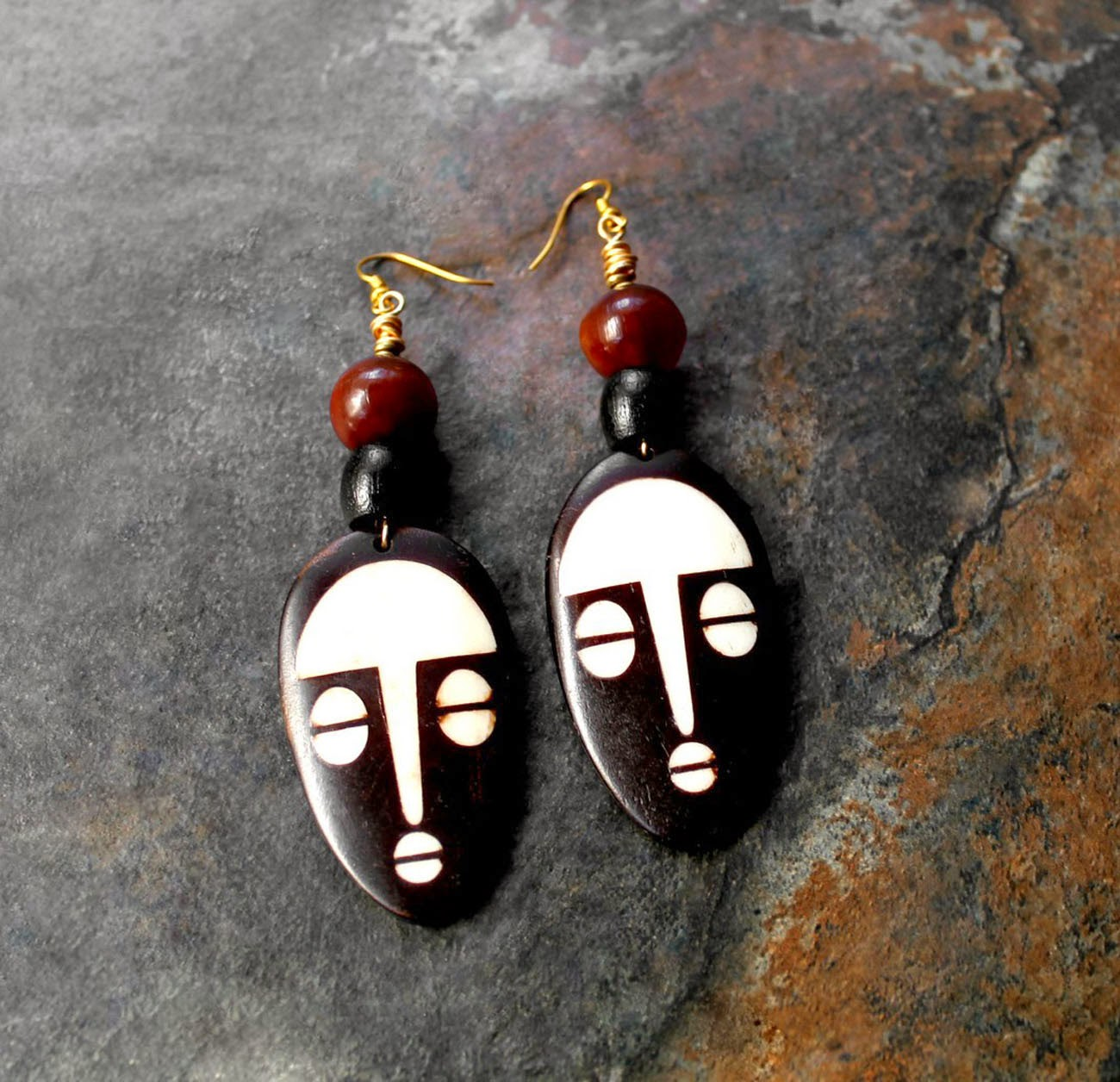 african bone mask pendant earrings