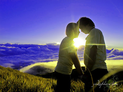 Two lovers romantically enjoying the peak of Mt. pulag with sunrise
