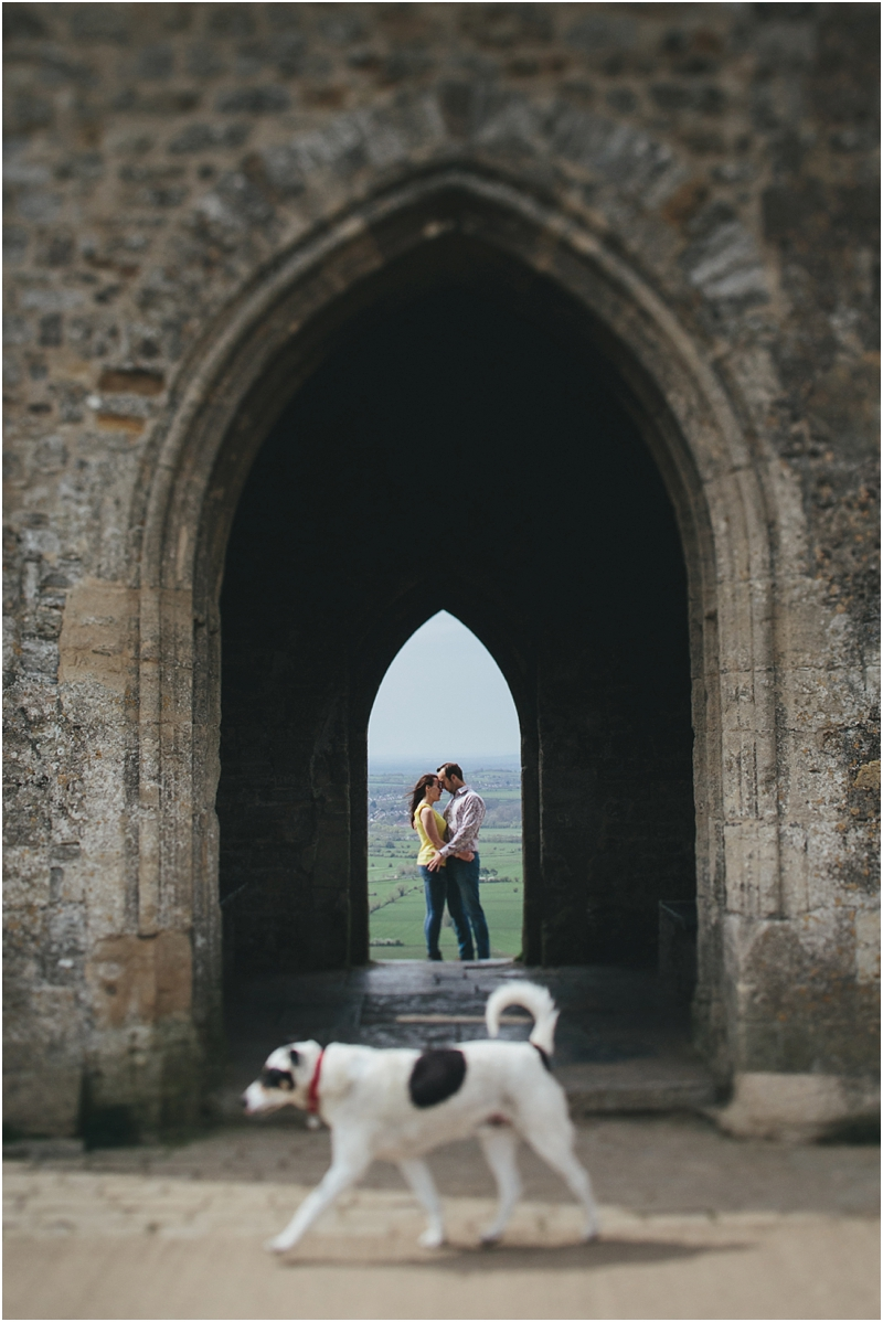 A couple kissing by Glastobury Tor