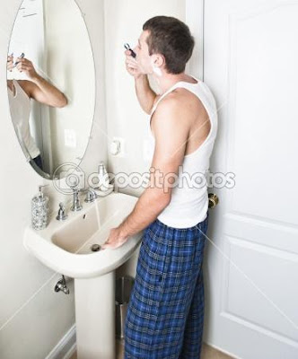 Young-Man-in-Bathroom-Shaving - What Men Want in your bathroom