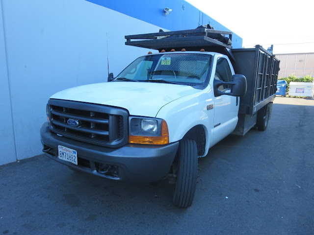Flat bed construction vehicle after collision repairs at Almost Everything Auto Body