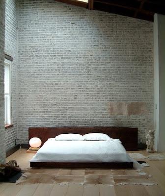 dormitorio pared ladrillo a la vista