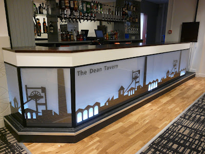 bar refurbishment, Function room, refurbished back-lit bar at Dean Tavern by cb3 design architects Bar shows back lit graphic, hardwood flooring and patterned carpet  The Dean Tavern, SJS Property Services, EGE
