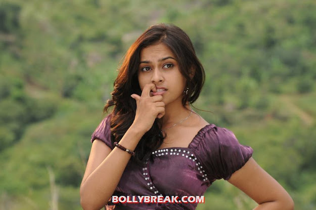Sri divya in purple top doing cute face movements -  Sri Divya cute face expressions
