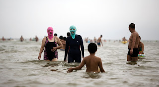 Women wearing masks on the beach