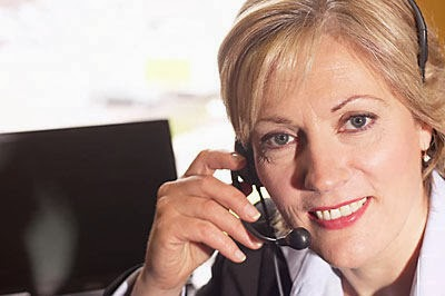 woman talking on telephone headset