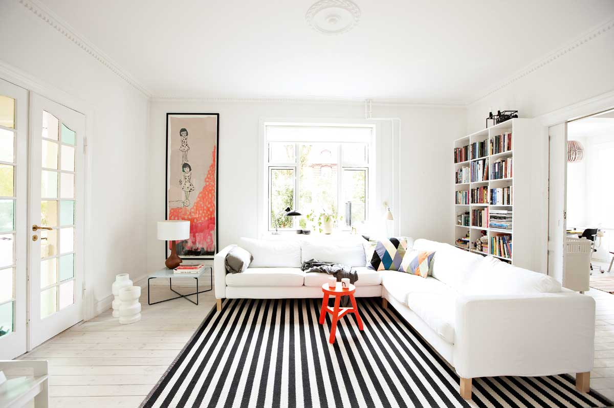 Living room modern orange accents black and white striped rug white
