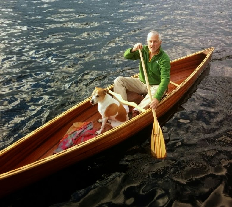 man in canoe with dog: simplelivingeating.com