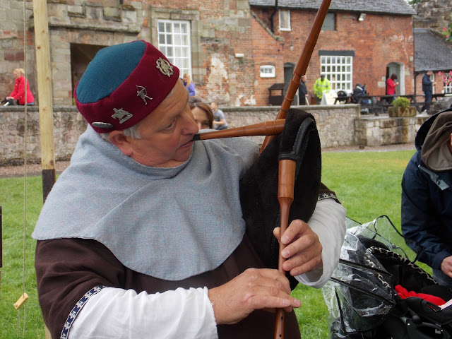medieval pipes played in costume