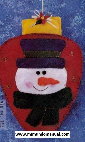 Adorno para la puerta de navidad mimundomanual for Adorno navidad puerta entrada