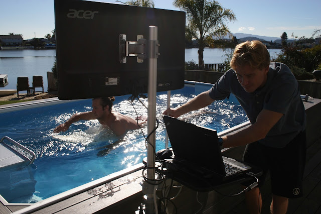 Rob Case, monitoring the video of a client's stroke in his Endless Pool, at his Surfing Paddling Academy.