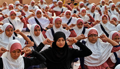 Indian Muslim students practice yoga at a school ahead of first International Yoga Day in Ahmedabad, India