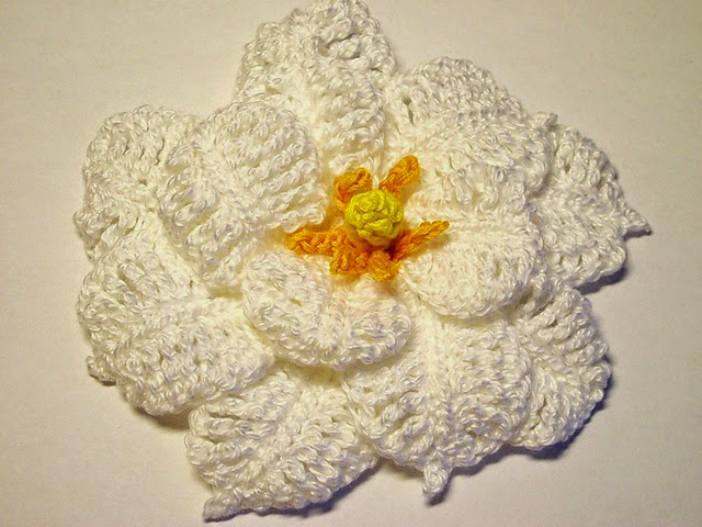 http://www.ravelry.com/patterns/library/white-gardenia-crochet-flower-pattern