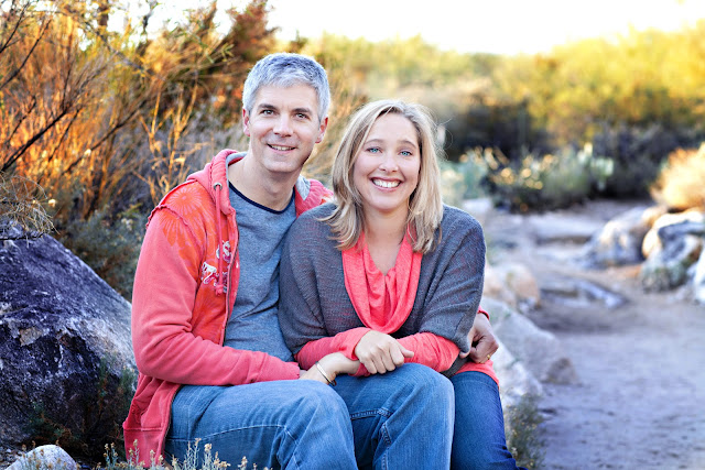 Couple poses for family portrait in Tucson desert
