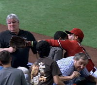 Martin Prado bumps heads with fan